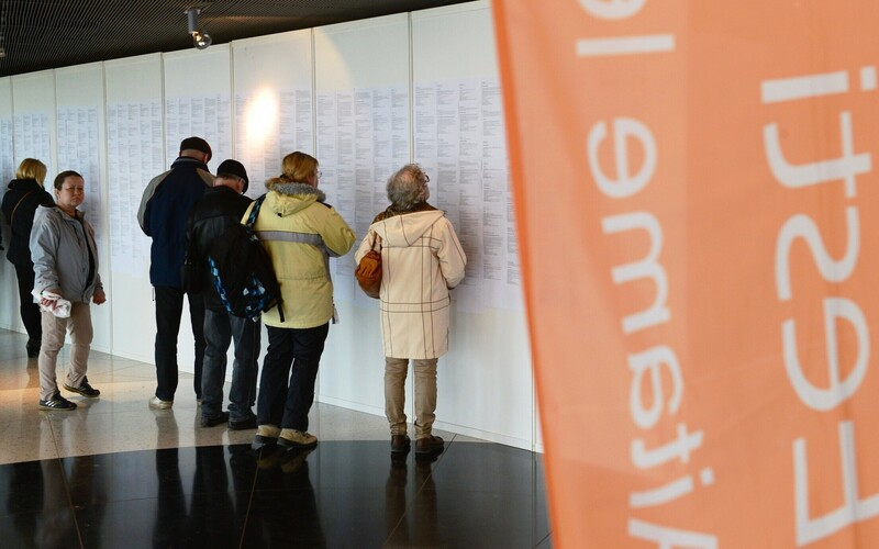 People reading job ads at a job fair in Tartu. April 2017.