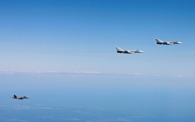 Finnish fighter jet and two Russian Su-24s.