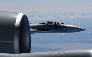 The close approach of a Russian Su-27 to a U.S. Air Force reconnaissance jet over the Baltic Sea on June 19.
