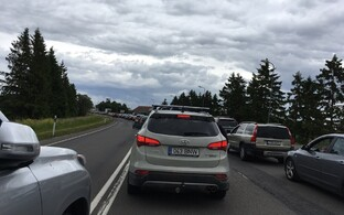 Line of cars leading up to Port of Kuivastu and the ferry back to the mainland on Sunday afternoon. June 25, 2017.