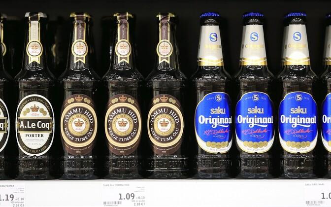 A. le Coq and Saku Õlletehas beers on a supermarket shelf.
