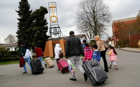 Семья беженцев. Иллюстративное фото.