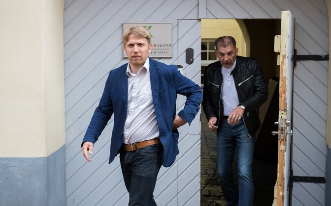 Center Party deputy chairman Jaanus Karilaid (left) leaving party headquarters in Tallinn.