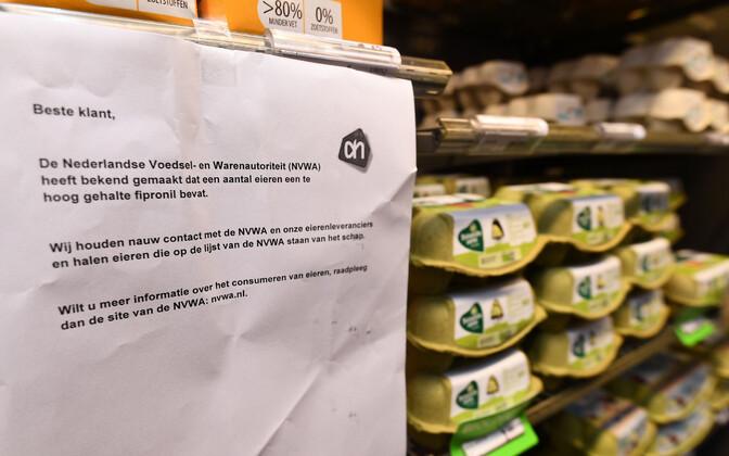 Hollandi toiduohutusameti hoiatus kapluses munariiuli juures.