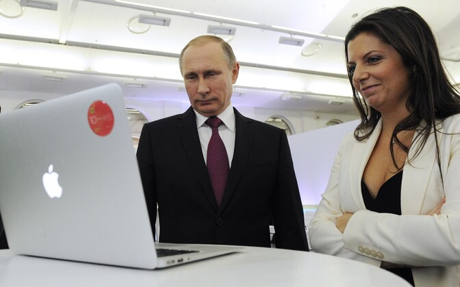 Russian President Vladimir Putin and editor-in-chief of Rossiya Segodnya, Margarita Simonyan. The Estonian state doesn't consider the agency and its subsidiaries to be independent media companies.