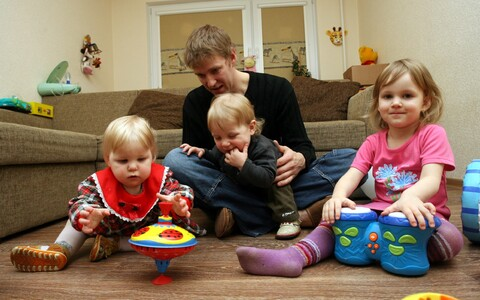 A father at home with his young children. Estonia has one of the most generous parental leave systems in the world.