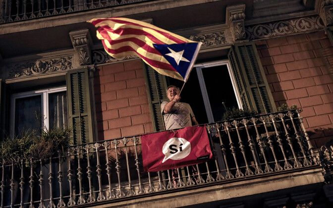 Man waving the Catalonian flag after polling stations in Barcelona were closed on Sunday.