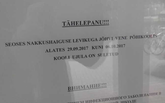 A bilingual sign at Jõhvi Russian Basic School indicating that the pool is closed through Oct. 6.