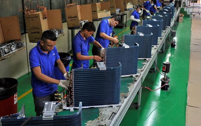 Tootmistöölised Hiinas.