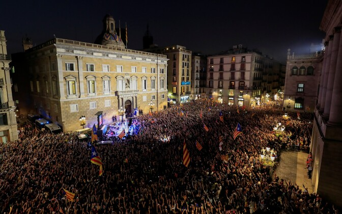 People celebrating in front of the regional parliament in Barcelona after it had voted for Catalan independence on Friday. Oct. 27, 2017.