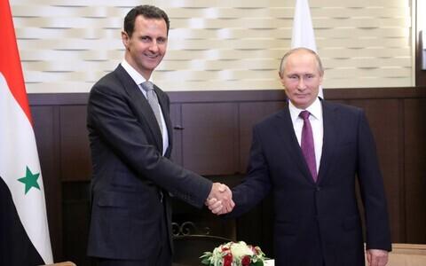 Президенты России и Сирии Владимир Путин (справа) и Башар Асад.