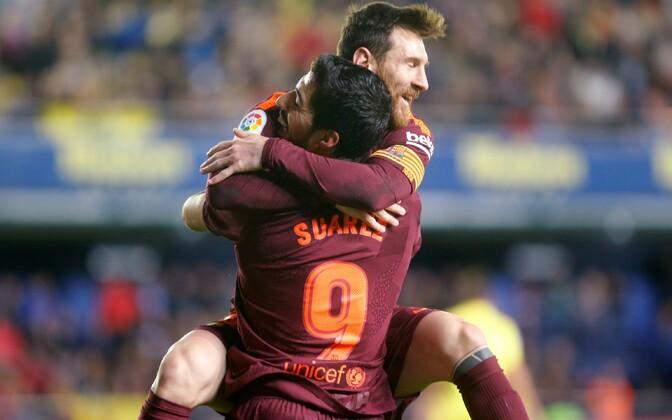Luis Suarez ja Lionel Messi