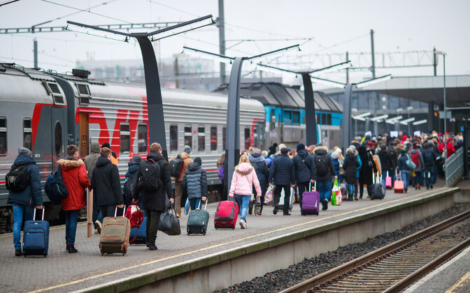 Russian tourists arriving in Tallinn by train.