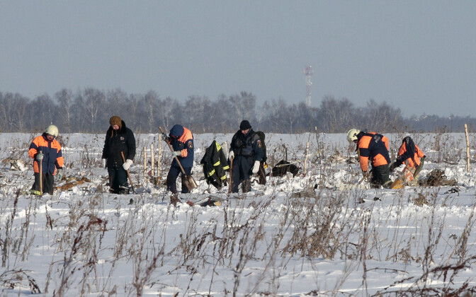 Russian Ministry of Emergency Situations members working at the crash site of the Saratov Airlines flight that crashed on Sunday, killing all 71 on board. Monday, Feb. 12, 2018.