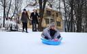 Taavi Hallimäe sledding down Kassitoome Hill as his friends watch on Shrove Tuesday in Tartu. Feb. 13, 2018.