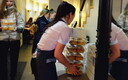 Employees bringing out more boxes of preordered lenten buns at Tartu's Werner Café on Shrove Tuesday. Feb. 13, 2018.