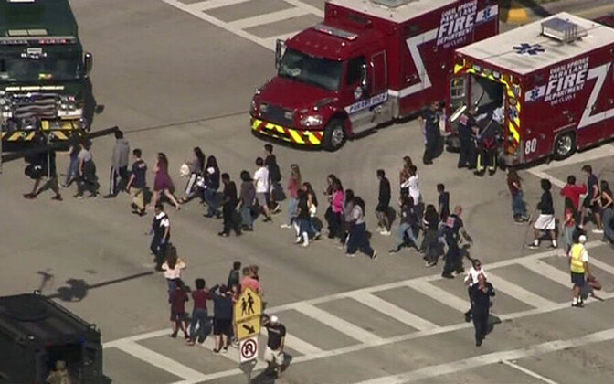 Students were evacuated following a fatal shooting at Marjory Stoneman Douglas High School in Florida. Feb. 14, 2018.