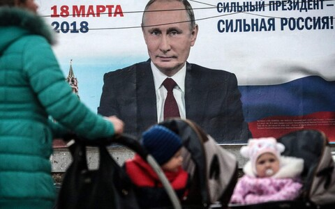 Russian President Vladimir Putin and the slogan
