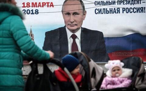 Russian President Vladimir Putin and the slogan