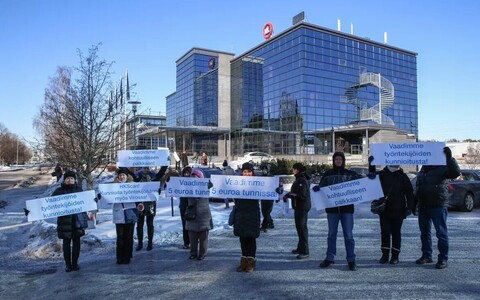 Employees of the Rakvere meatpacking plant protesting outside HKScan's headquarters in Turku, Finland.