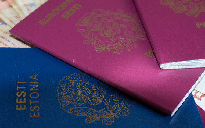 Pre-EU Estonian passport (blue) and EU-era Estonian passport (dark red).