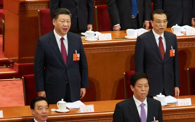 Председатель КНР Си Цзиньпин (слева).