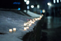 Candles lit along Tallinn's Harju Street commemorating the March Bombing of 1944.