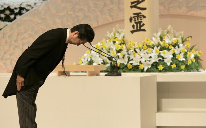 Премьер-министр Японии Синдзо Абэ на памятной церемонии 11 марта.