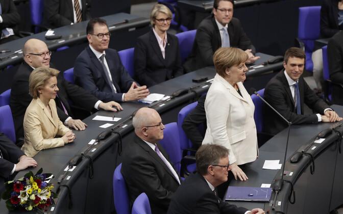 Ангела Меркель после голосования в бундестаге 14 марта.
