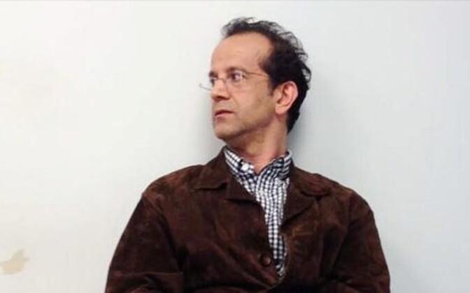 Reza Olangian pärast vahistamist 2012. aastal.