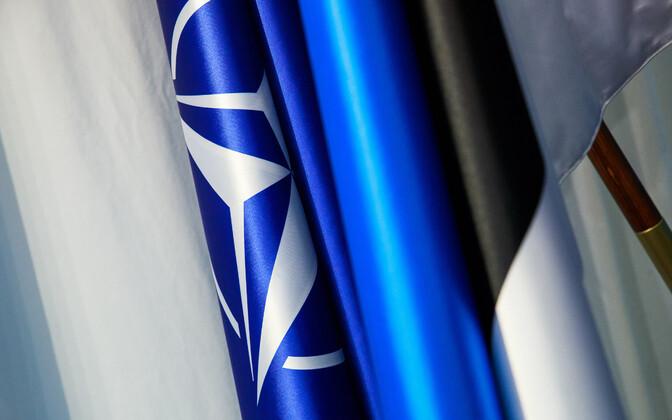 NATO and Estonian flags.