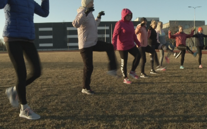 Members of the public training at a sports field in Haapsalu.