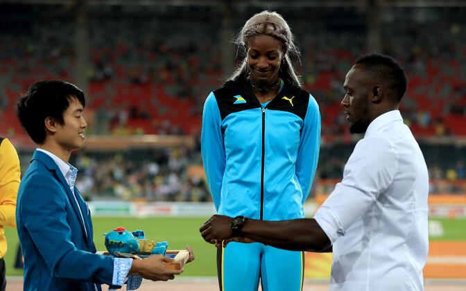 Shaunae Miller-Uibo ja Usain Bolt
