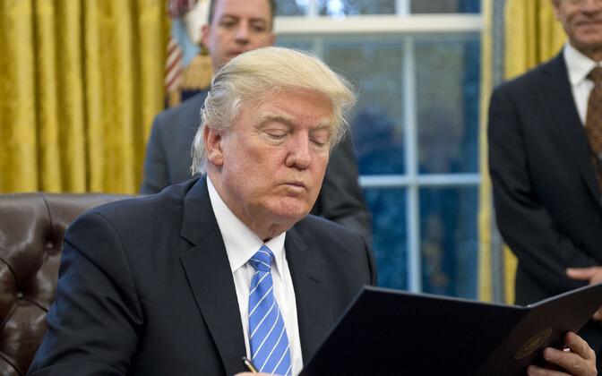 USA president Donald Trump allkirjastamas TPP-st taandumist 2017. aasta jaanuaris.