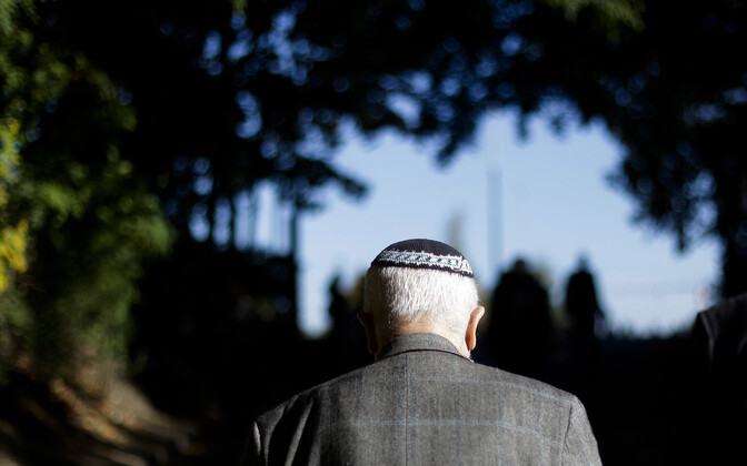 Pigimütsi kandev mees Berliinis.