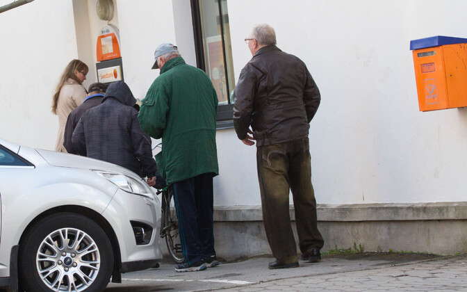 Pensioners in line by an ATM.