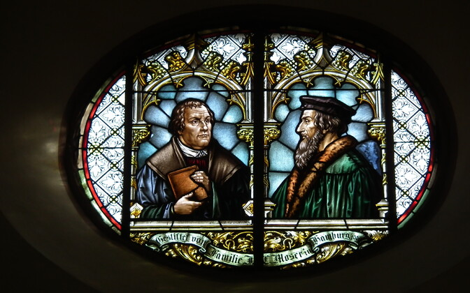 Stained glass window in Wiesloch Church, Baden-Württemberg, Germany, featuring Martin Luther (L) and Jean Calvin (R)