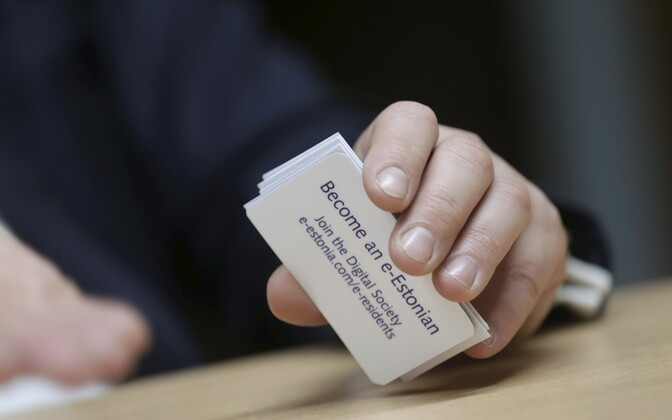 Taavi Kotka, former CIO of the Estonian government, holding cards promoting Estonia's e-Residency program.