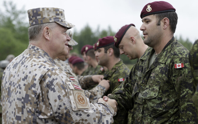 Latvian Defence Chief Raimonds Graube (L) meeting Canadian troops