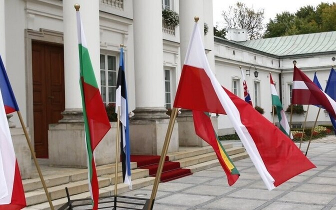 Flags of the Bucharest Nine countries in Warsaw yesterday