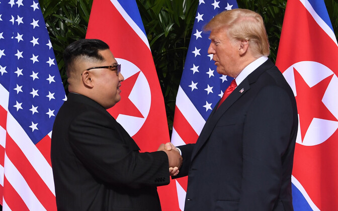 Kim Jong-un and Donald Trump shake hands on Tuesday. 12 June, 2018.