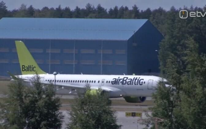 An Air Baltic Airbus A220-300 on the runway at Tallinn Airport.