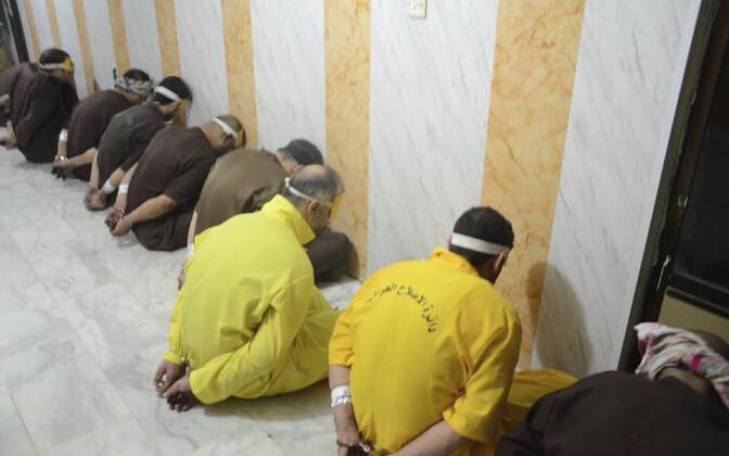 Iraagi justiitsministeeriumi poolt avaldatud foto süüdimõistetutest vahetult enne hukkamist.