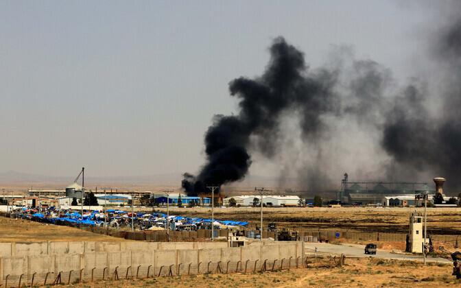 Jordaania poolelt tehtud foto lahingutest Süüria lõunaosas.