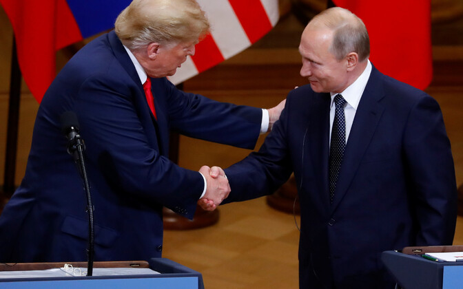 US President Donald Trump and Russian President Vladimir Putin shake hands at their joint press conference in Helsinki on Monday. 16 July, 2018.
