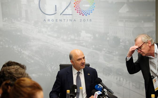 Euroopa Liidu rahandusvolinik Pierre Moscovici G20 pressikonverentsil (keskel).