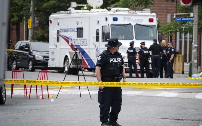 Kanada politseinikud sündmuskohal Torontos 23. juulil.