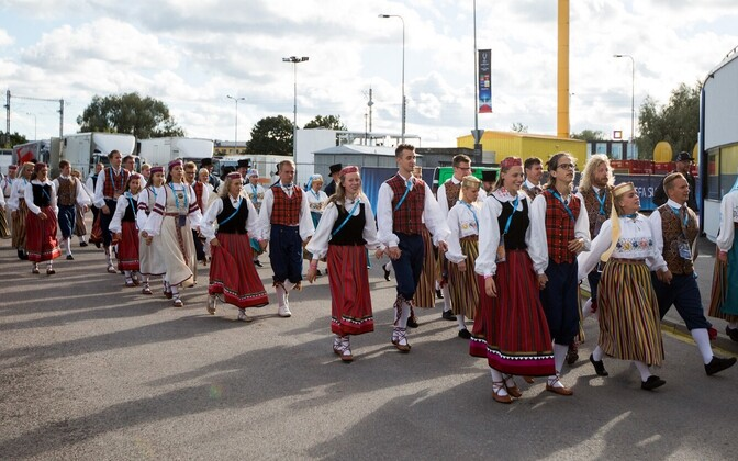 Not long to go now. Dancers in traditional Estonian garb make their way to the Lilleküla Stadium in Tallinn ahead of Wednesday's Super Cup.
