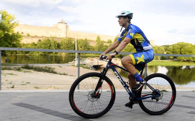 President Kersti Kaljulaid riding a bike in Narva, August 2018.