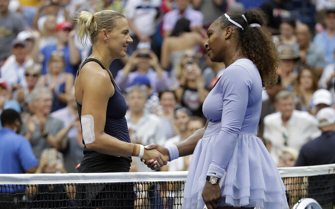 Kaia Kanepi (left) and Serena Williams shake hands at the end of Ms. Williams' fourth round victory against the Estonian.